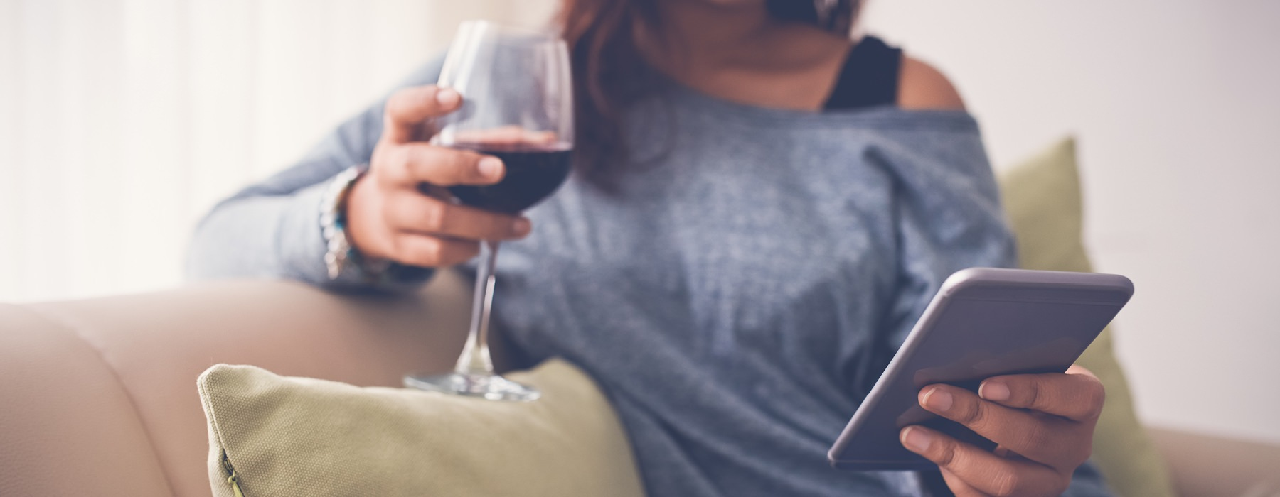 Woman drinking wine and on phone